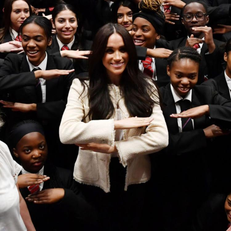 PHOTOS: Meghan Markle joins a group of students to make the equality sign on International Women's Day