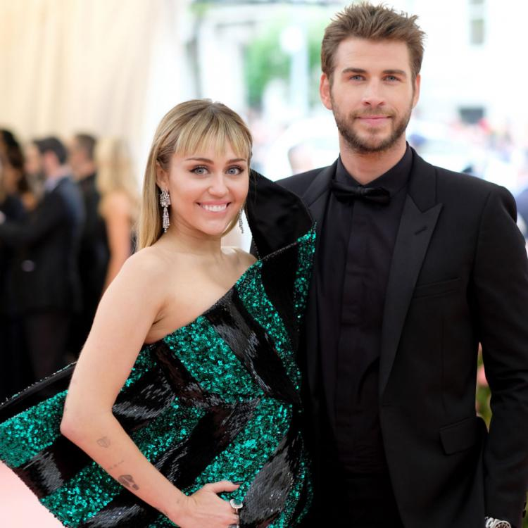Liam Hemsworth's family doesn't want him getting back together with Miley Cyrus after Kaitlynn Carter kiss?