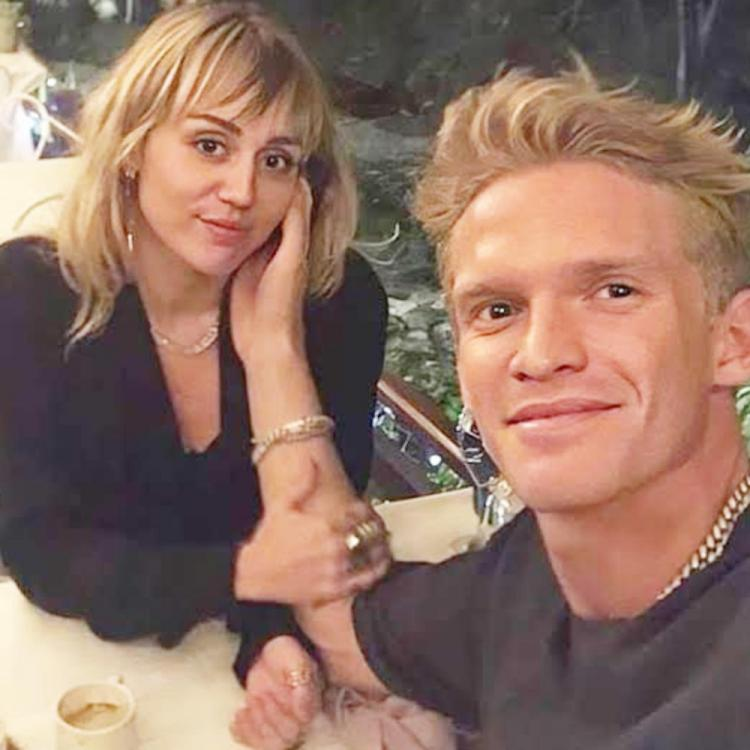 Miley Cyrus blushes as beau Cody Simpson reads her a love poem; Watch