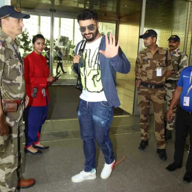 PHOTOS: Arjun Kapoor jetts off out of the city looking uber cool to ring in his New Year