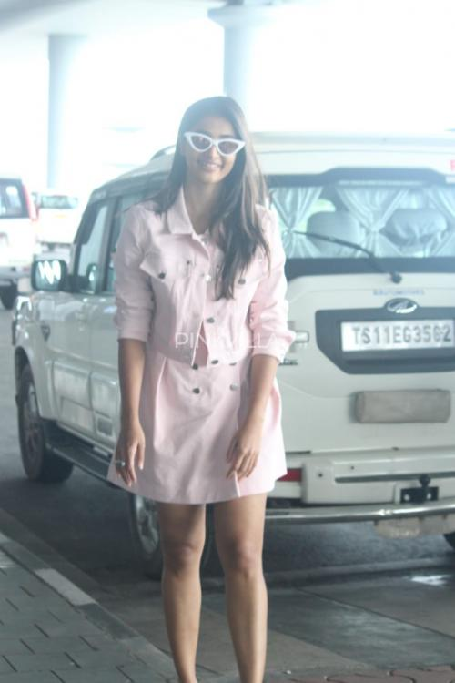 PHOTOS: AA 19 actress Pooja Hegde keeps it trendy in pastel pink as she gets papped at the airport