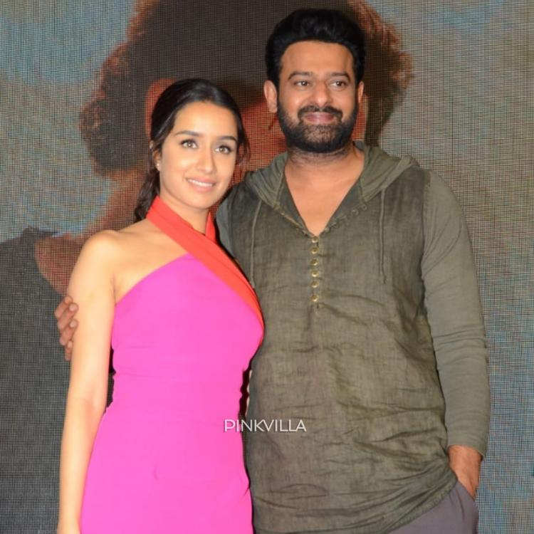 PHOTOS: Saaho star Prabhas looks dapper while his co star Shraddha Kapoor rocks a pink outfit at a press meet