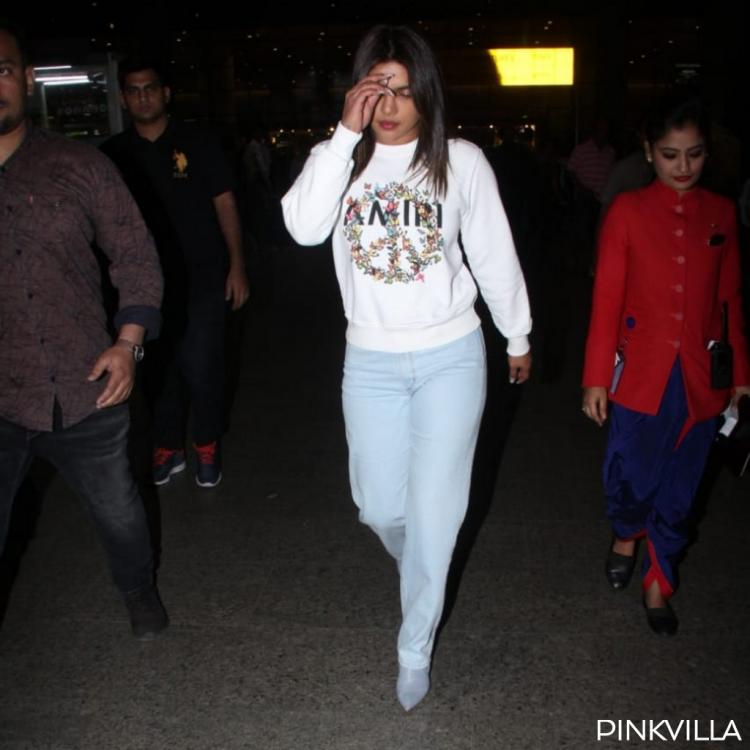 Priyanka Chopra looks every bit classy and fashionable at the airport as she arrives Mumbai; View Pics