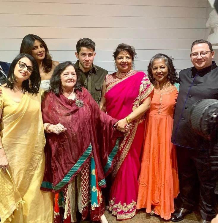 Priyanka Chopra and Nick Jonas look lovely in the photo from their reception hosted by Denise & Kevin Jonas