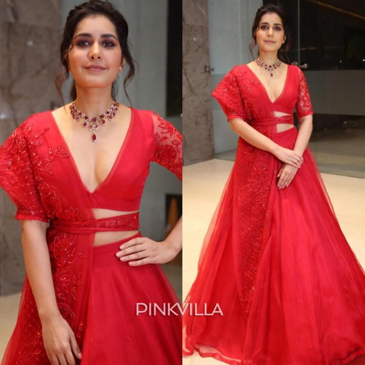 Raashi Khanna is elegance personified and a sight to behold in an alluring scarlet lehenga by Manish Malhotra