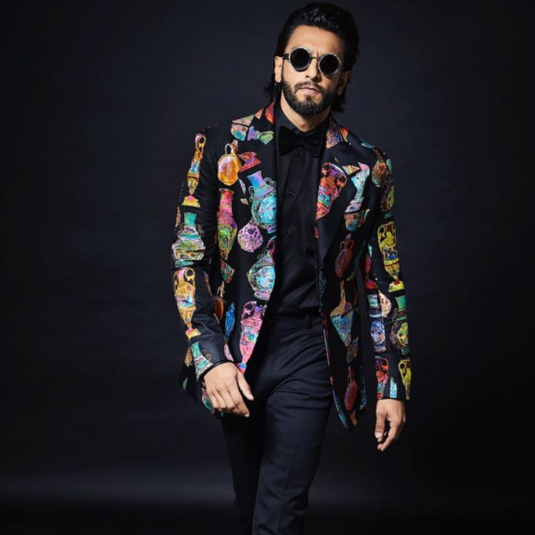 Ranveer Singh adds a quirky touch to his all black look with his printed jacket and we love it; see PHOTOS