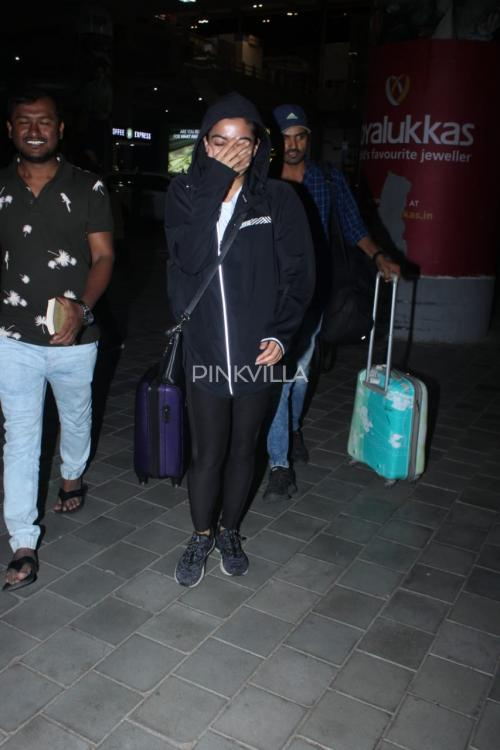 PHOTOS: Rashmika Mandanna is in no mood for pictures as she gets papped at Hyderabad airport