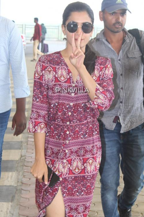 Rashmika Mandanna keeps it spunky at the airport in a boho dress with a high slit; View Pics