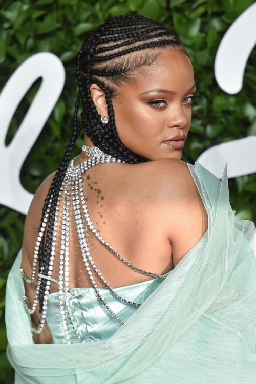 Rihanna stuns the audience as she shows up in a gorgeous teal dress by Fenty and we're all for it