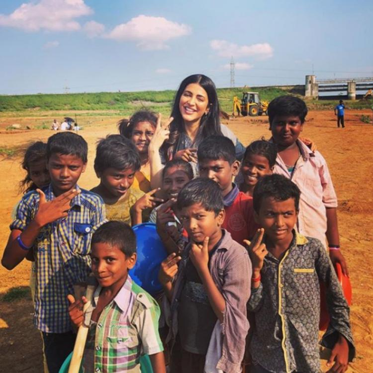 Shruti Haasan is a bundle of joy as she poses for a PIC with a bunch of kids; check it out