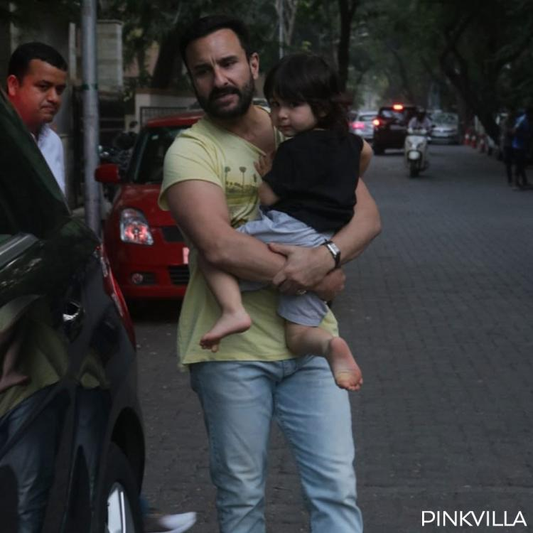 PHOTOS: Taimur Ali Khan adorably clings to daddy Saif Ali Khan as they step out for a drive