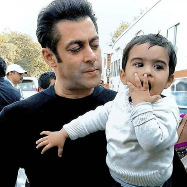 Salman Khan gazing at a little kid's expressions in this throwback PHOTO is cuteness overloaded; Take a look
