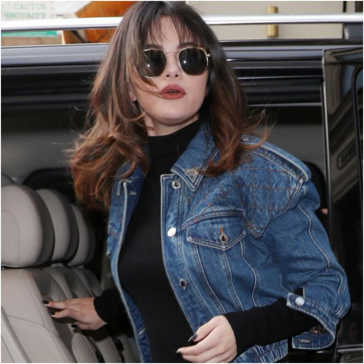 Selena Gomez channels her inner 'Rachel Green' in a retro look with bangs & a denim outfit