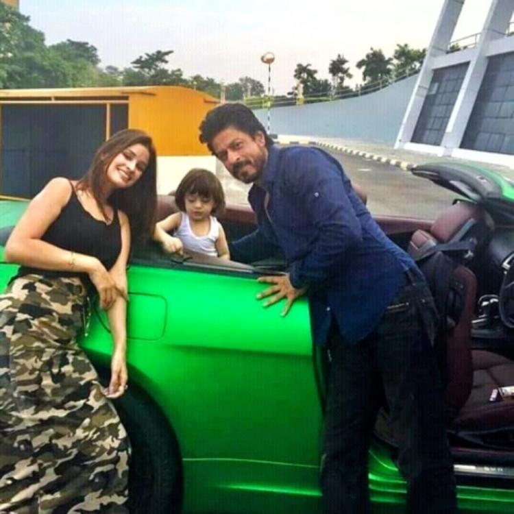 Shah Rukh Khan can't stop smiling as AbRam plays nearby in a rare BTS PHOTO from the sets of Dilwale