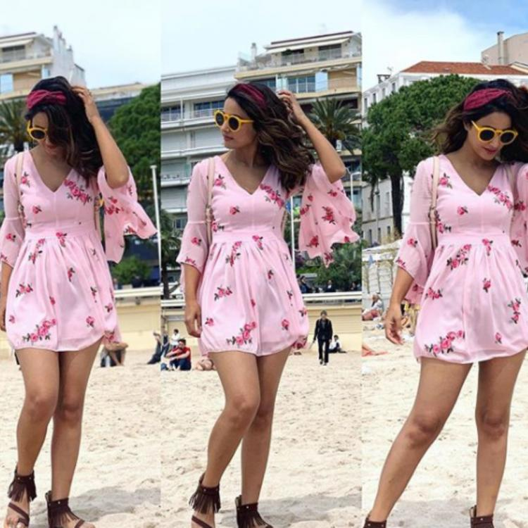 Hina Khan is a happy water baby as she poses in a pink dress by the beach; view PIC
