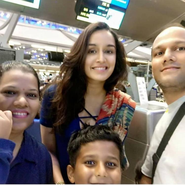 Shraddha Kapoor looks elated as she poses for a selfie with a family; Check it out