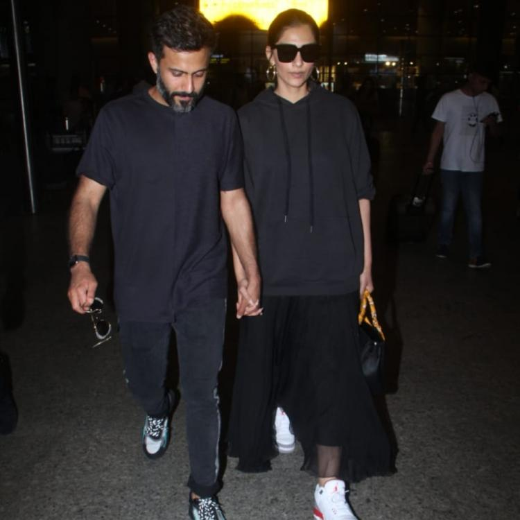 Airport Diaries: Sonam Kapoor and husband Anand Ahuja twin in black and we are all hearts