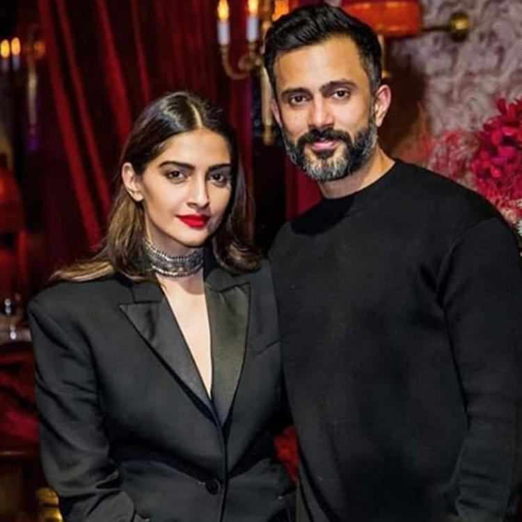 Sonam Kapoor and Anand Ahuja bid goodbye to the decade with a kiss; Says 'May love lead your way'