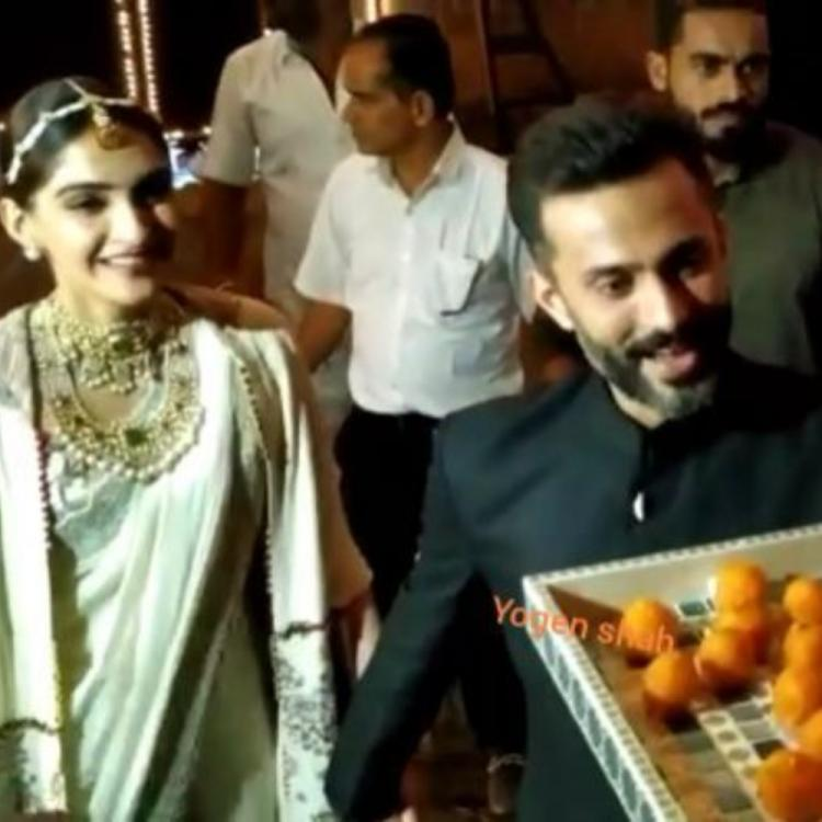 Sonam Kapoor & Anand Ahuja offer laddoos to the paps on Diwali and win the internet with their sweet gesture
