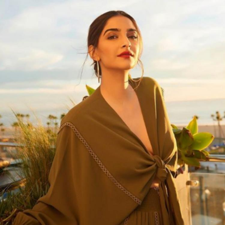 Sonam Kapoor gives teams her cropped knot shirt with a skirt & we absolutely love it