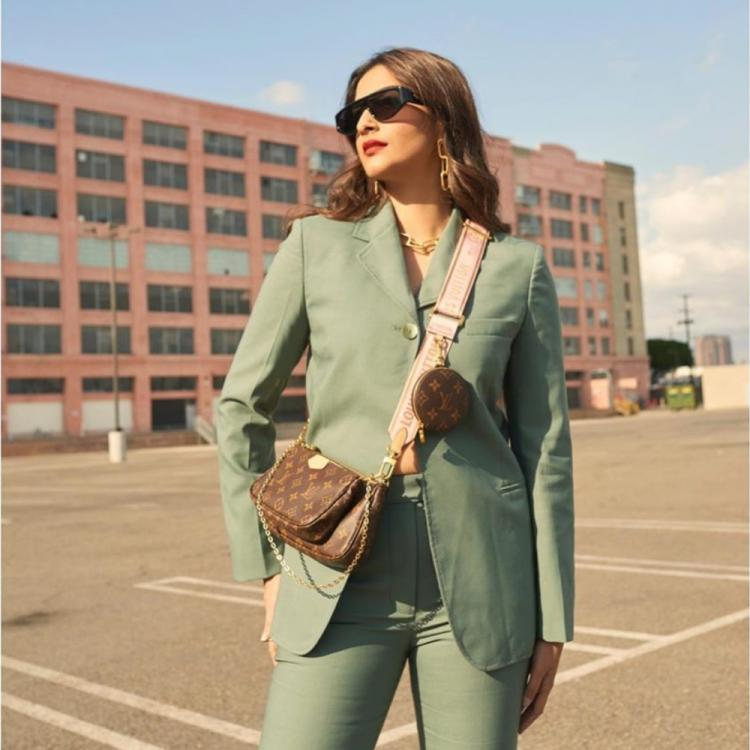 Sonam Kapoor makes for a perfect boss lady as she dons a mint green pantsuit; See Pics