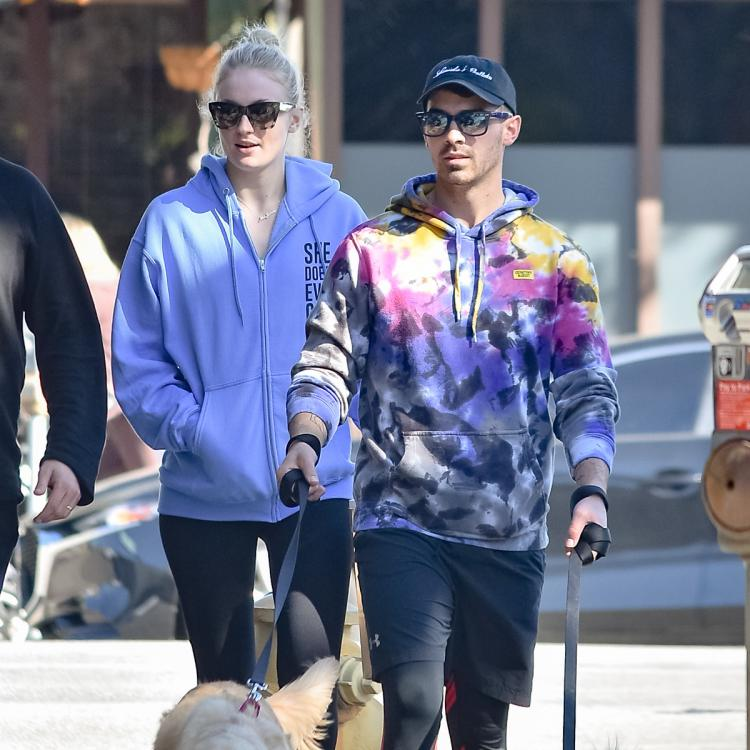 PHOTOS: Pregnant Sophie Turner covers her baby bump in a blue hoodie during a breakfast run with Joe Jonas