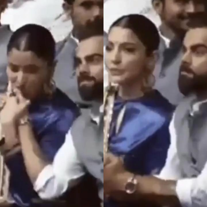 Anushka Sharma gives a peck on Virat Kohli's palm as they attend the conference and we are all hearts; WATCH
