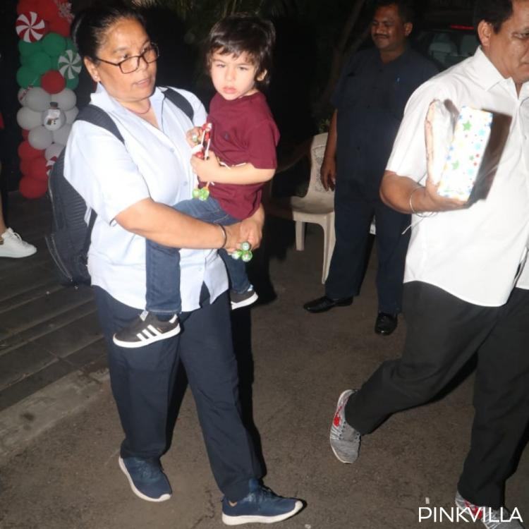 PHOTOS: Taimur Ali Khan clings to his nanny as they come out after a Christmas party