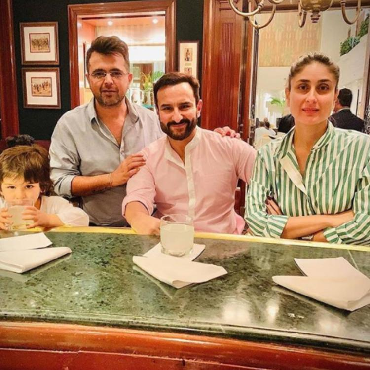Taimur Ali Khan poses with his drink on a dinner outing with parents Kareena Kapoor Khan and Saif Ali Khan