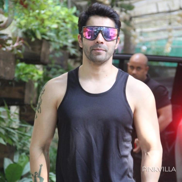 PHOTOS: Varun Dhawan opts for two toned pair of shades as he clubs them up with an all black ensemble