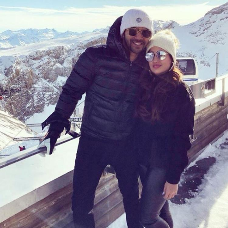 Varun Dhawan rings New Year with girlfriend Natasha Dalal; Sends wishes to fans with a lot of snow and love
