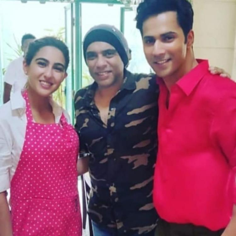 Sara Ali Khan & Varun Dhawan are a bundle of cuteness as they strike a pose on the sets of Coolie No 1