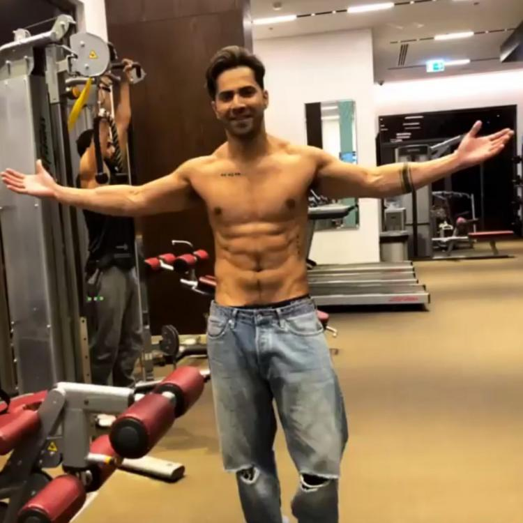 Varun Dhawan showing off his washboard abs will set the internet on fire; See pics