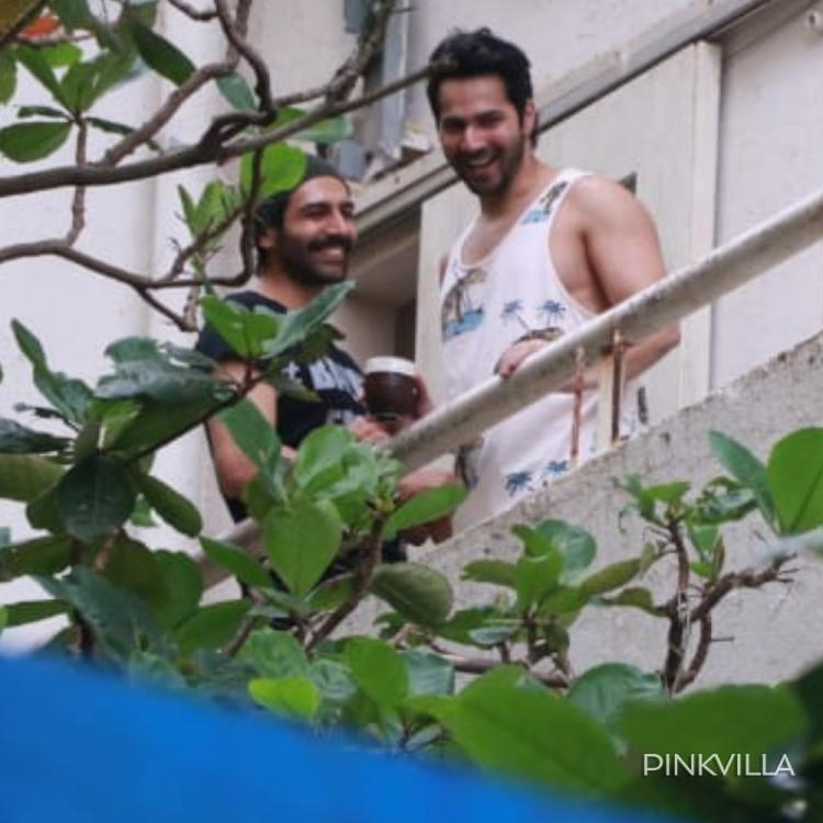 Varun Dhawan and Kartik Aaryan bond over a fun conversation and we wonder what they're talking about; See Pics
