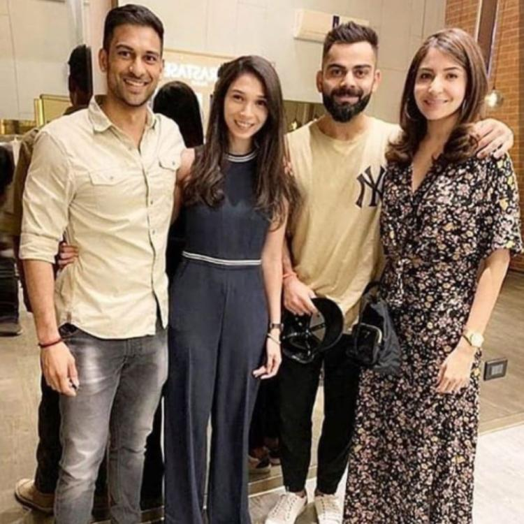 Anushka Sharma & Virat Kohli are in a happy mood as they pose with their fans; View Pic