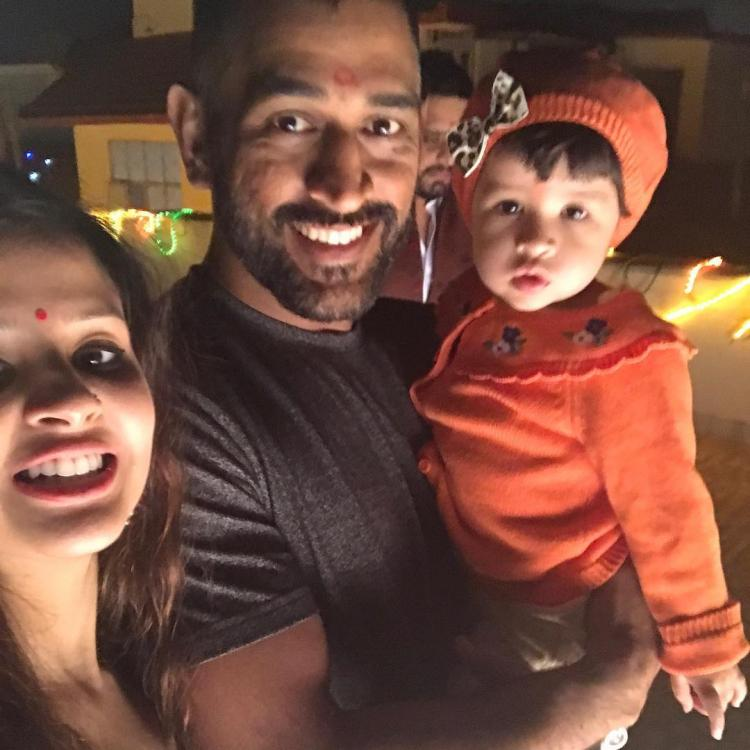 Image result for ms dhoni with sakshi and ziva