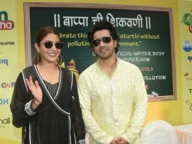 Anushka Sharma and Varun Dhawan attend an event in style