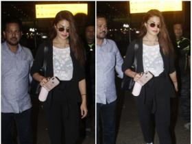 Jacqueline Fernandez gets snapped by the shutterbugs at airport