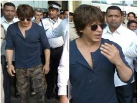 SRK gets snapped in the city by the paparazzi