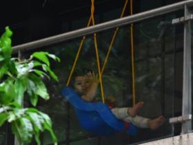 Taimur Ali Khan happily waves at the paparazzi from his balcony while getting papped