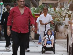 Taimur looks cute as a button as he gets snapped in his stroller