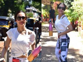 Malaika Arora dons a crop top with workout leggings & smiles as she gets papped at her yoga studio; See PHOTOS