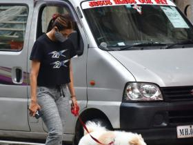 PHOTOS: Malaika Arora sports a grey and black athleisure look as she takes her furry friend out for a stroll