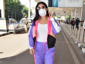 PHOTOS: Sara Ali Khan spotted being a responsible citizen by wearing a mask against COVID 19 at the airport