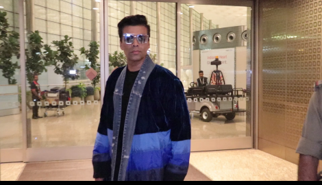 Karan Johar arrives at the airport in style